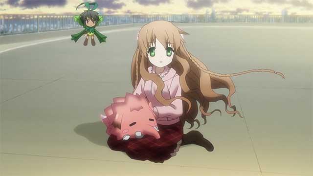 Kotori sitting on ground with pet