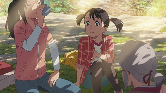 Miyamizu family relaxing outdoors.